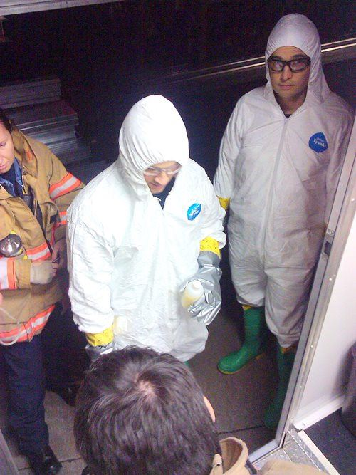 Two people standing while in hazmat suits